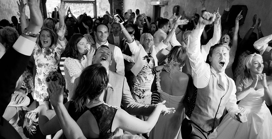Whole wedding party dancing on the dancefloor