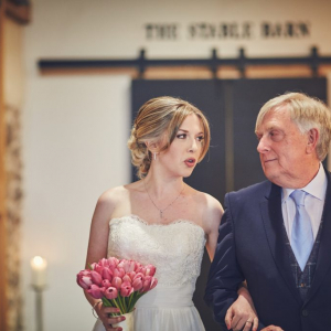 Father walks Bride through the Press Bar to ceremony