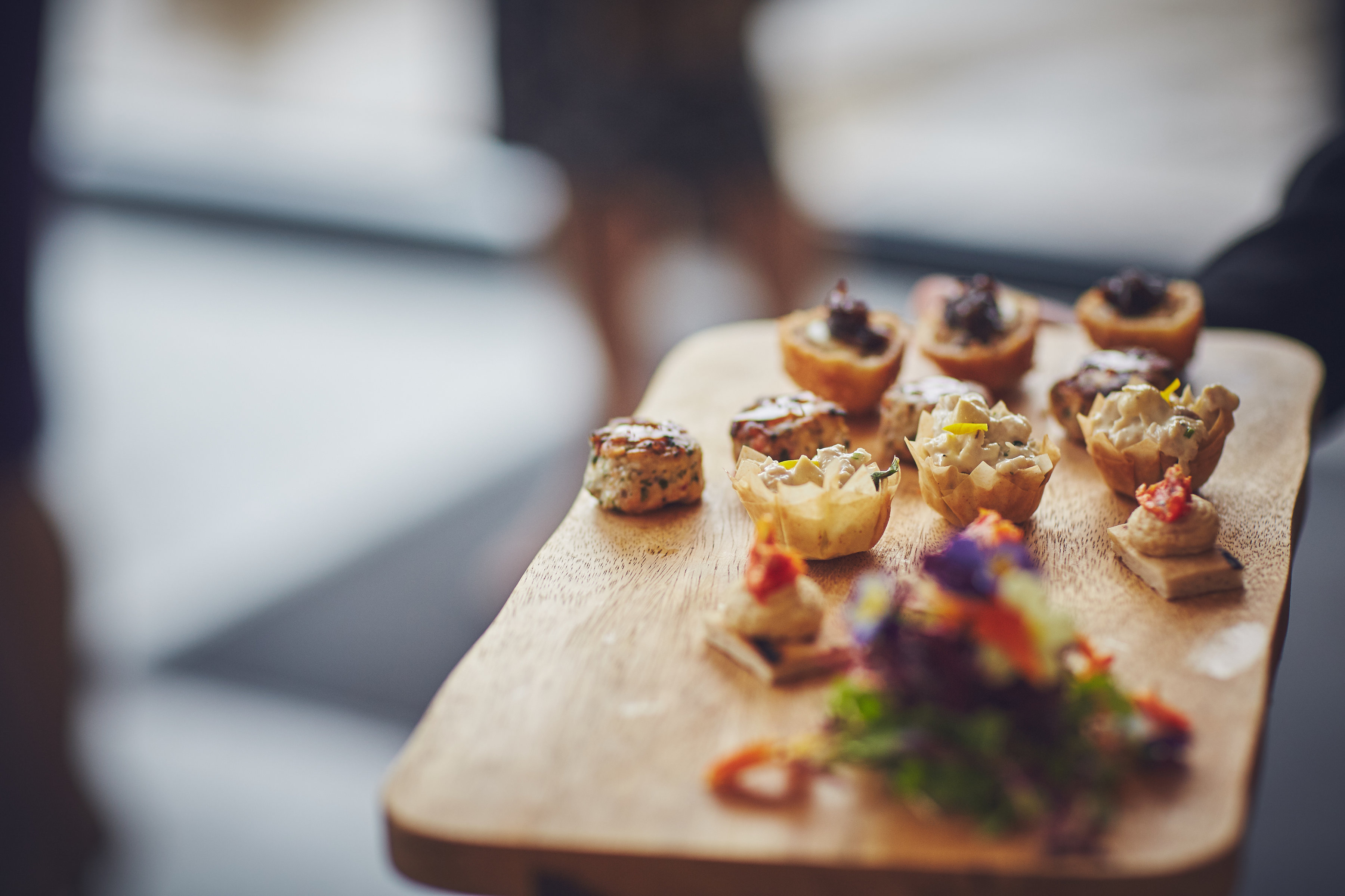 Canapes served on a wooden board
