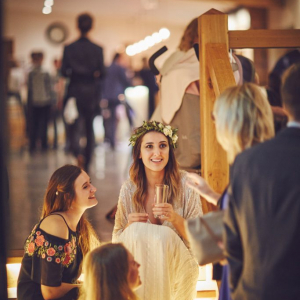 Bride seated on the lit up staircase