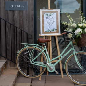 Bicycle with flowers outside the Press Bar