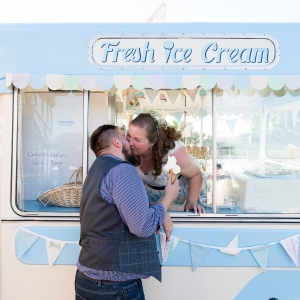 Newlyweds kiss at ice cream van