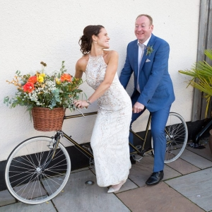 newlyweds on a bicycle made for two