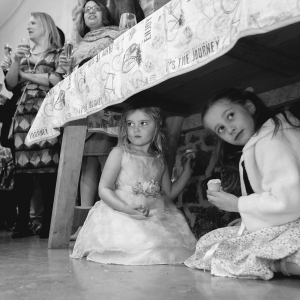 children sneak a snack under the table