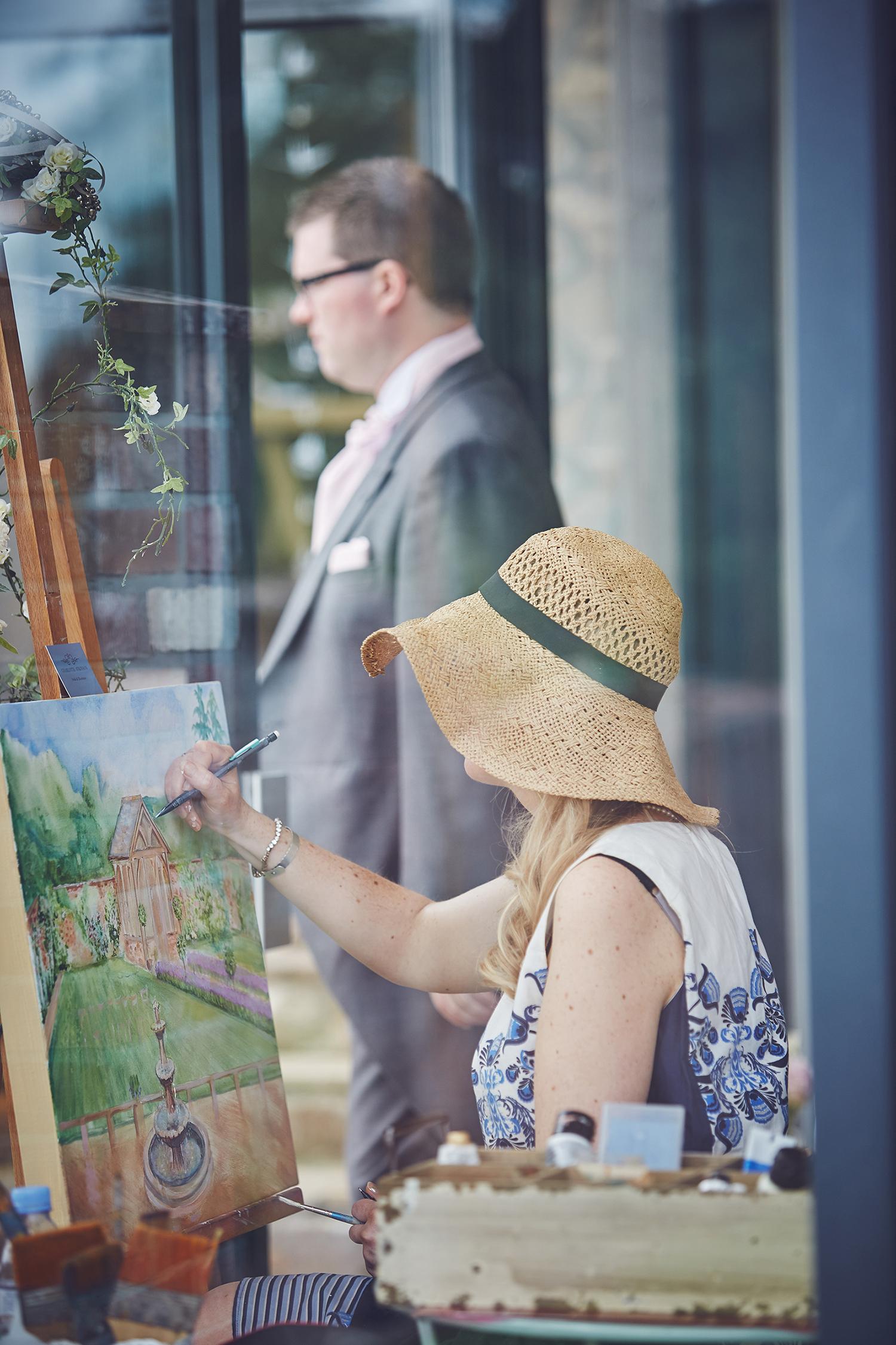 artist paints the garden
