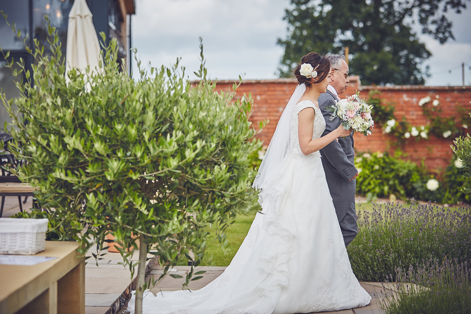 bride and her father walk the aisle