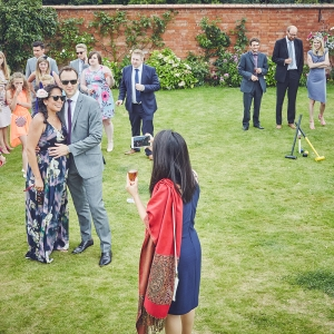 Guest mingle over croquet in the garden