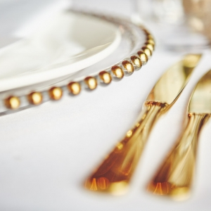 Gold cutlery close up