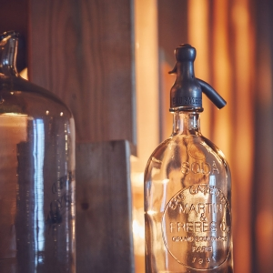 Soda bottle and demijohn closeup