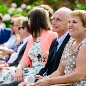 Wedding guest smile at exchange of vows
