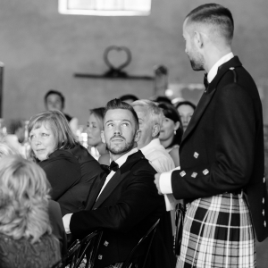 Groom reads his speech to his partner