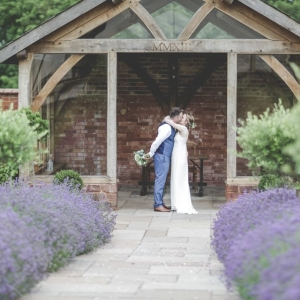 Couple kiss at the arbour