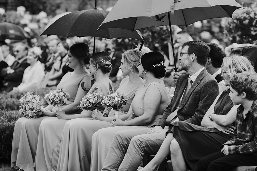 Bridesmaids seated at wedding ceremony