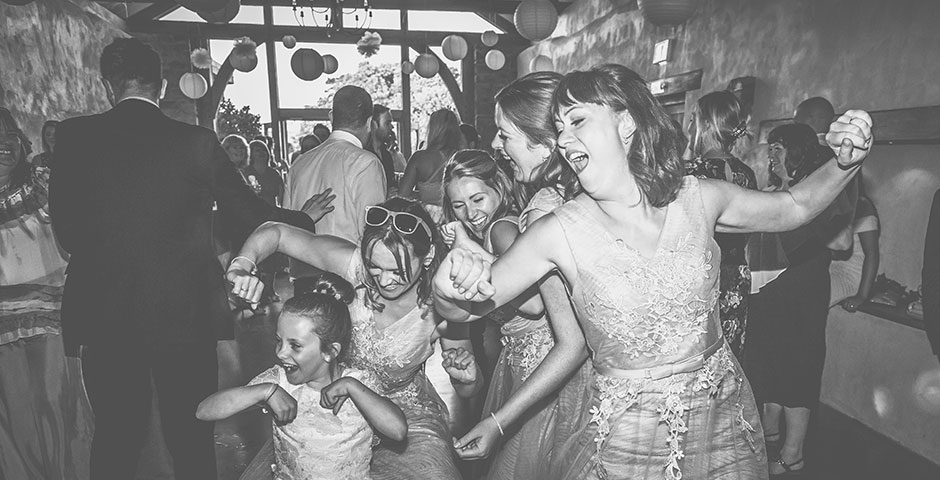 Bridesmaid getting their groove on the dancefloor