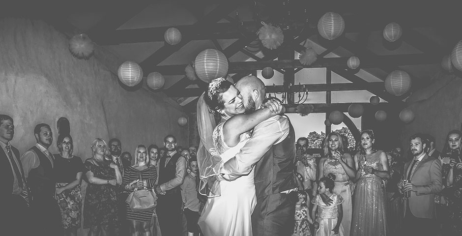 Couple laughing while enjoying their first dance
