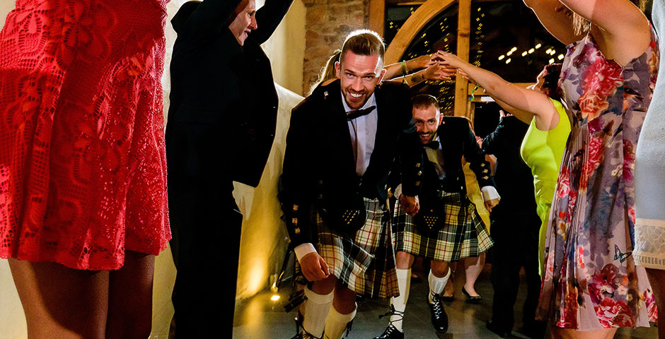 Groom and Groom dancing through the archway or arms