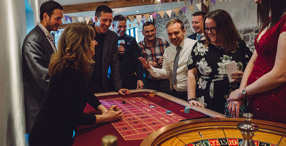 Roulette table surounded by wedding guests