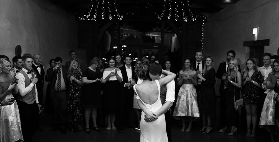 Tight embrace of couple during their first dance