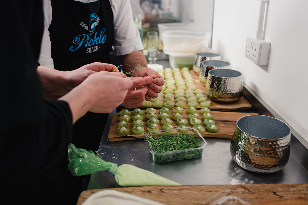 Close up of Pickle Shack chefs working