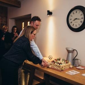 Claire & Richard Down cut celebratory cake