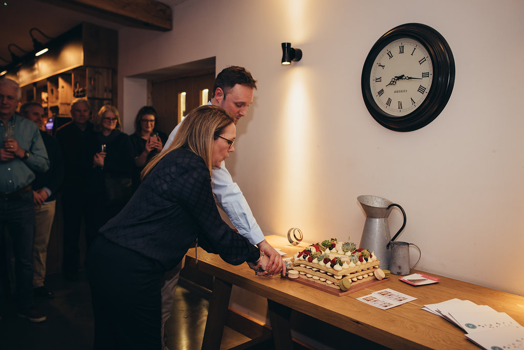 Claire & Richard Down cut celebratory cake