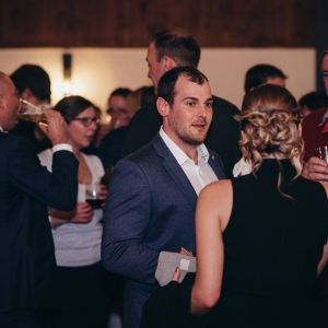 Guests mingle over drinks