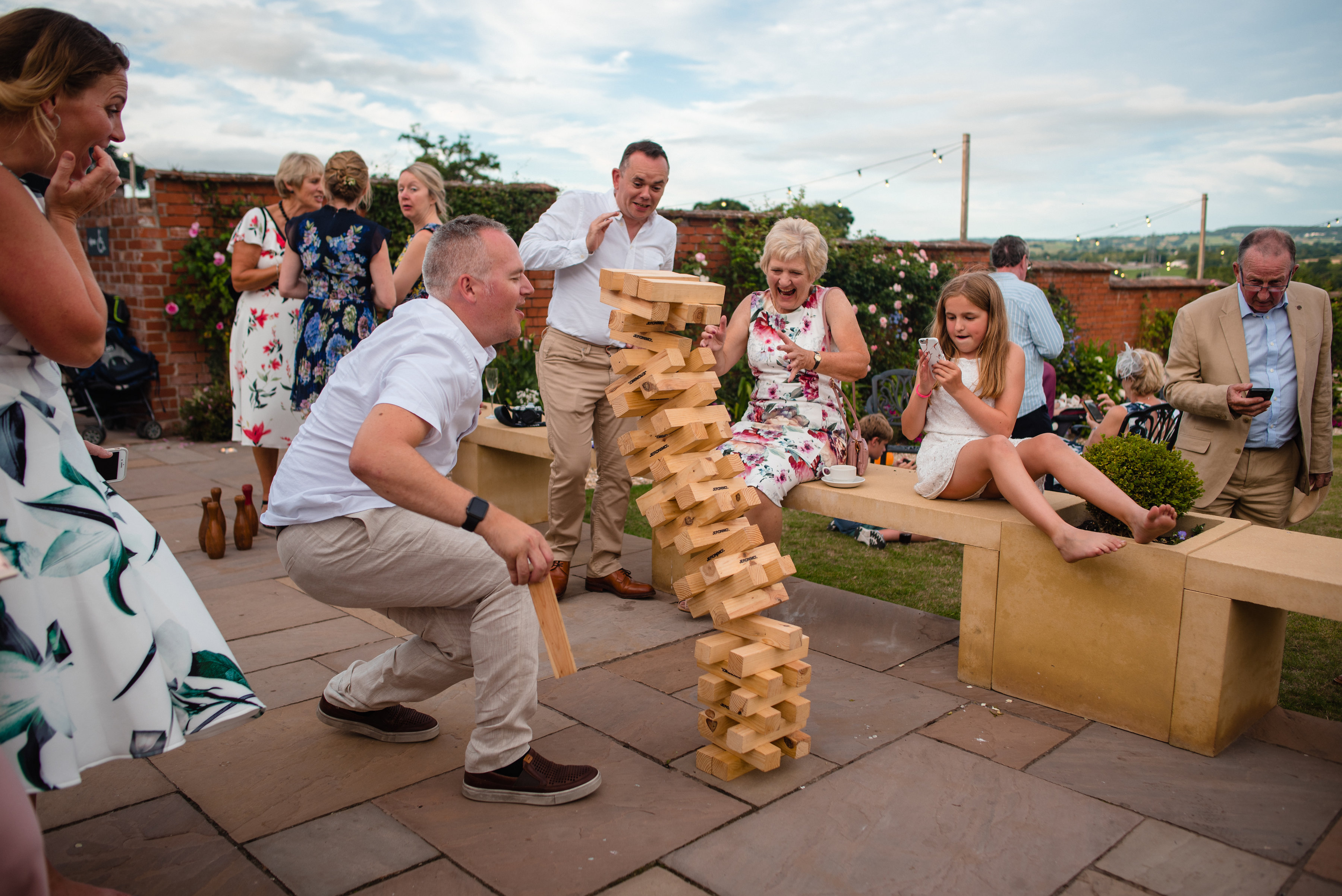 Family plays giant jenga