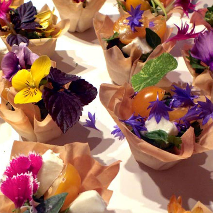 A plate of canapes with edible flowers