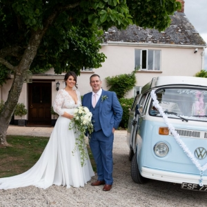 Bride and her father pose by VW Wedding Camper Van