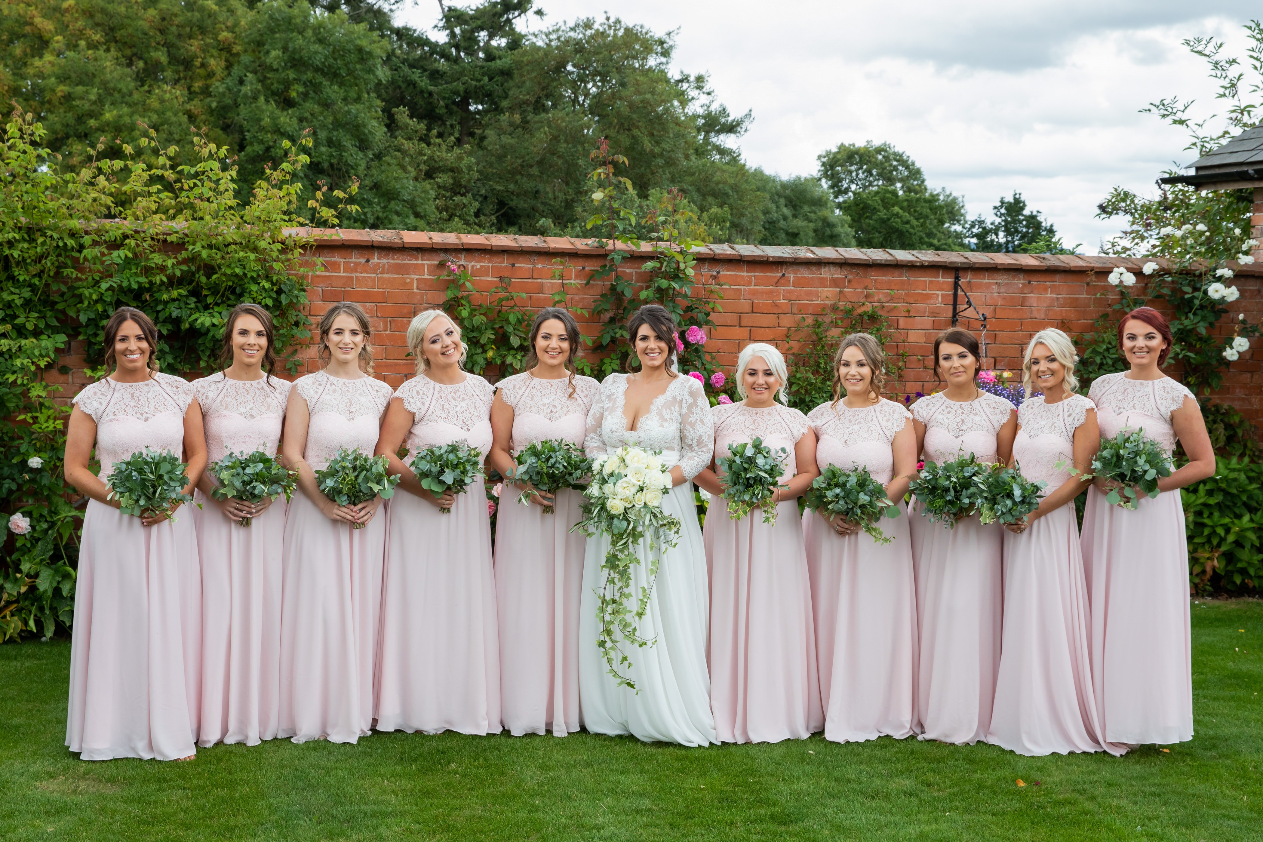 Bride and bridesmaids in the walled garden