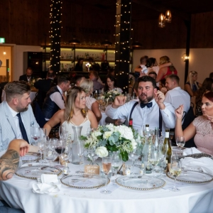 Guests enjoy wedding breakfast in The Stable Barn