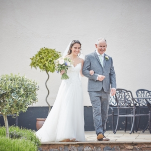 Bride arm in arm with her father