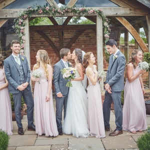 Bridal party infront of the arbor