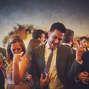 Wedding guests play air guitar