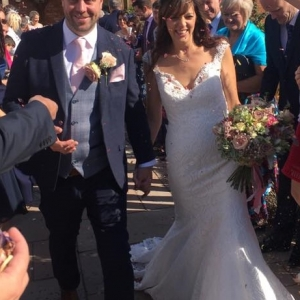 Bride and groom showered with petals