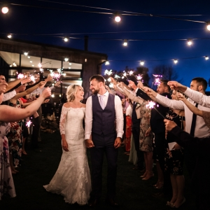 Bride and Groom under sparkler guard of honor