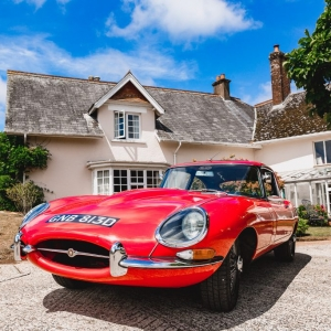 Wedding car on the driveway of Upton Barn & Walled Garden