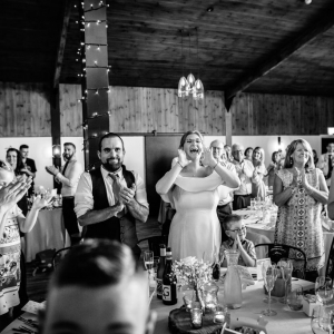 Guest clap and cheer at the Wedding Beakfast in The Stable Barn at Upton Barn & Walled Garden
