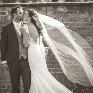 Bride and Groom kiss by the Walled Garden at Upton Barn