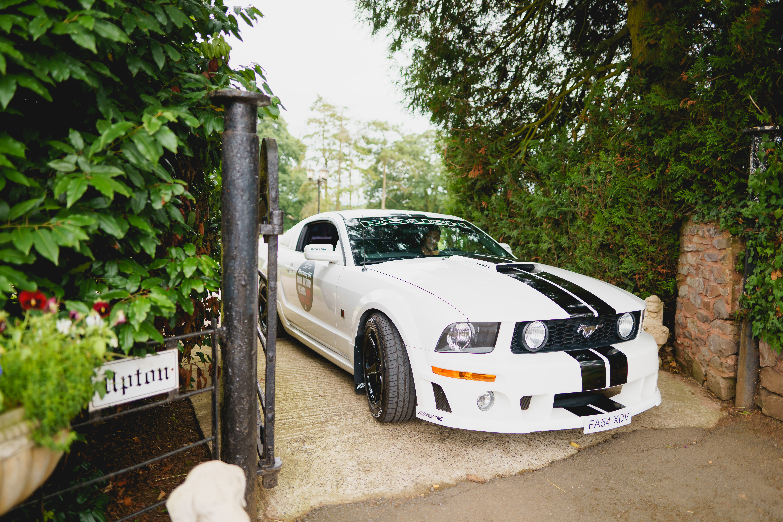 Wedding car Mustang arrives at Upton Barn & Walled Garden