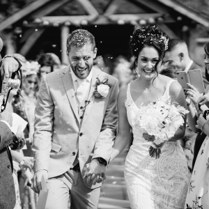 Bride and groom showered in confetti in the walled garden