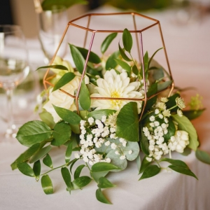 Close up of floral arrangement for the wedding breakfast table
