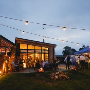 The Walled Garden at night with food truck