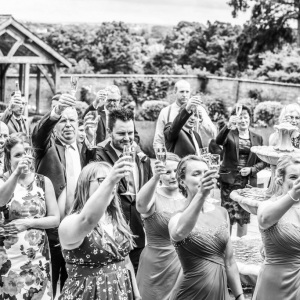 Guests toast the bride and groom in the garden