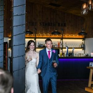 Bride and Groom arrive at their wedding breakfast