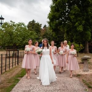 Bride and bridesmaid arrive at Upton Barn & Walled Garden
