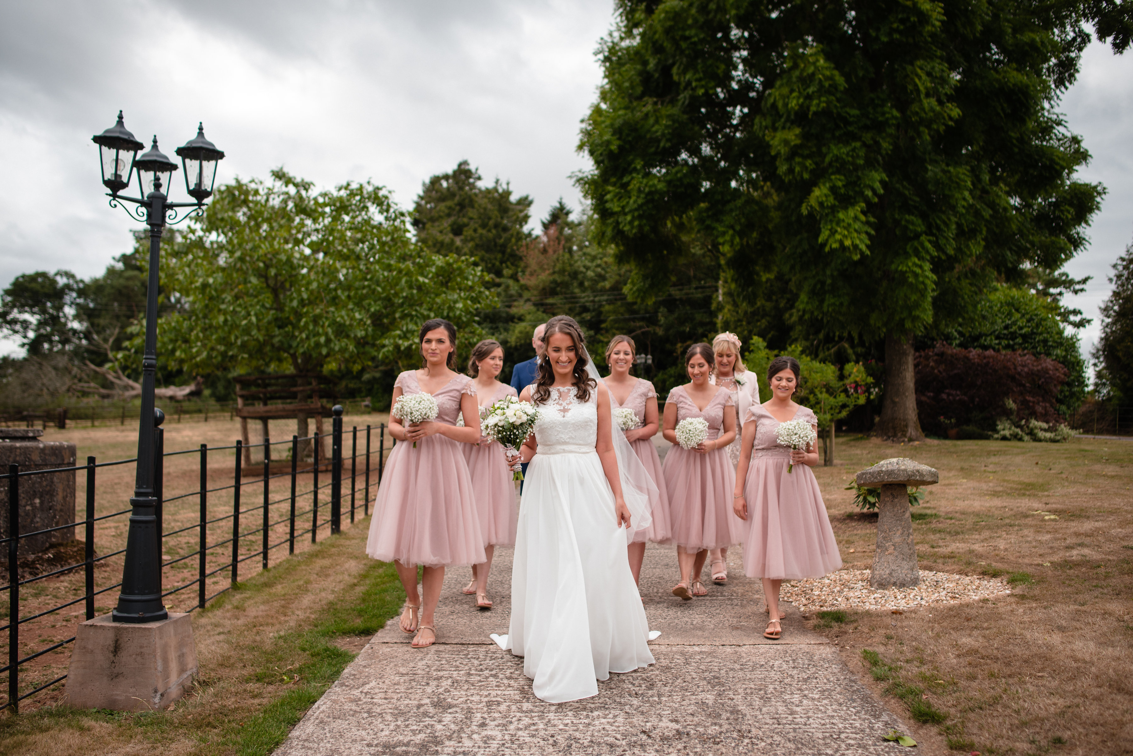 Bride and bridesmaid arrive at Upton Barn & Walled Garden