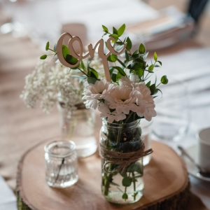 Flowers in jar and table number at Upton Barn & Walled Garden