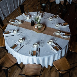 Above table image of wedding breakfast set up in the Stable Barn at Upton Barn & Walled Garden