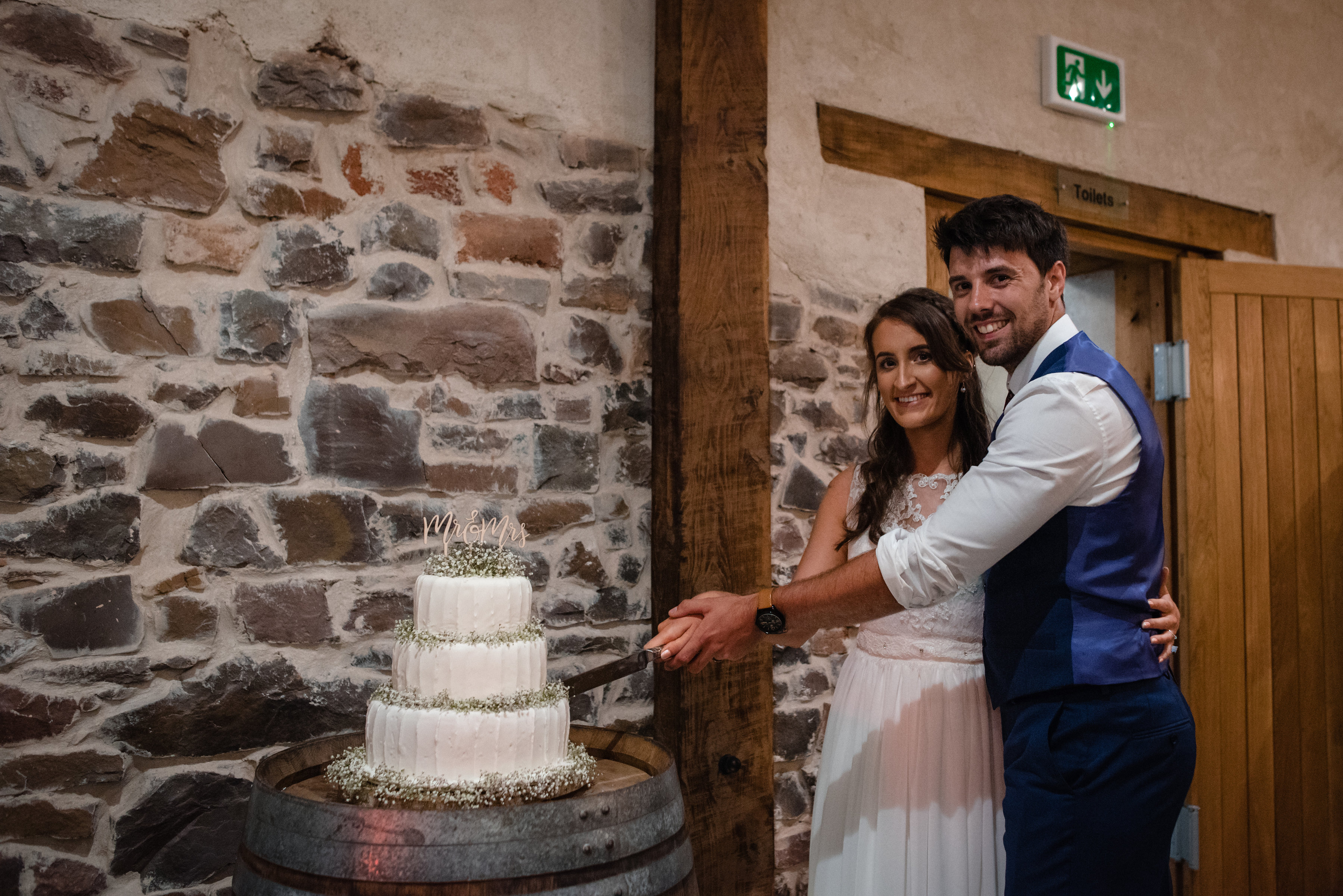 Bride and groom cut their wedding cake at Upton Barn & Walled Garden